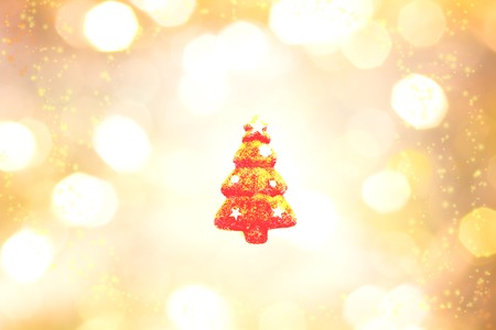 red christma tree outline on white, yellow, gold, and black color background. Christmas and showy image.