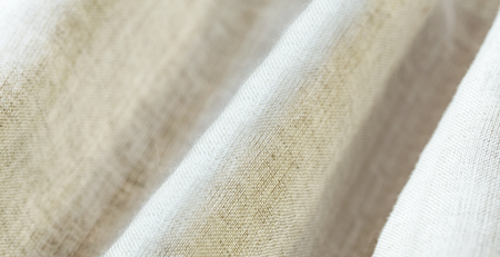Background texture of beige pattern fabric made of cotton or linen.closeup.