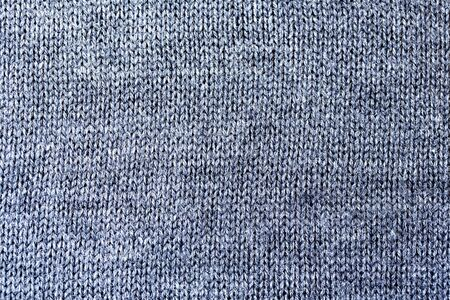 Background texture of grey pattern knitted fabric made of cotton or wool closeup