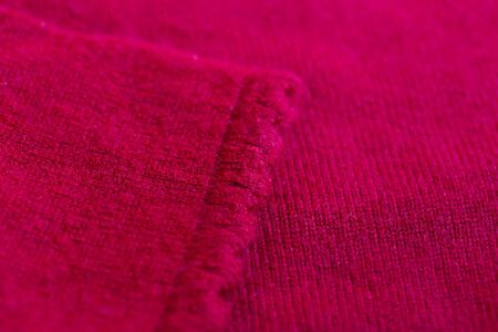 Beautiful, luxurious, The cuffs of the knitted sweater in red, close up. Banco de Imagens