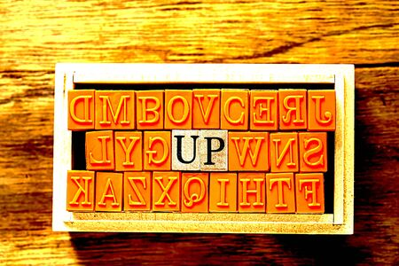 UP - isolated abstract in wood type stamps against wooden background and copy space.close up.