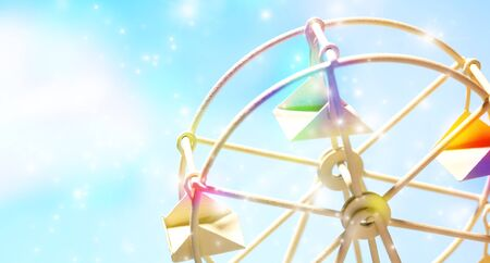 Colorful Ferris wheel of the toy on blue sky with sparkly background and copy space.
