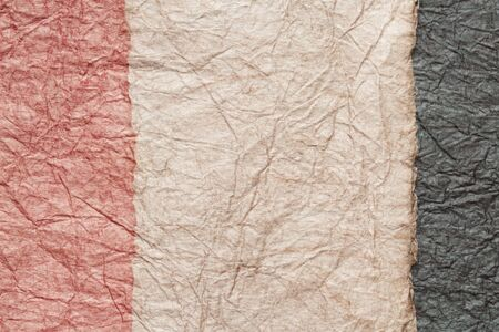 japanese abstract paper texture.3 colors of pink and beige and black. close up.