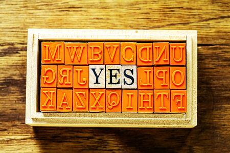 YES - isolated abstract in wood type stamps against wooden background and copy space.close up.