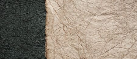 japanese abstract paper texture.2 colors of beige brown with black. close up.