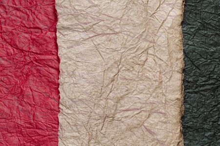japanese abstract paper texture.3 colors of dark red and dark beige and black. close up.