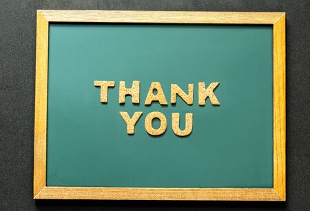 Set of THANK YOU of cork isolated on green blackboard and black color background and copy space. Flat lay.
