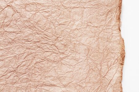 japanese abstract paper texture. Pink beige paper on white background. close up. 写真素材