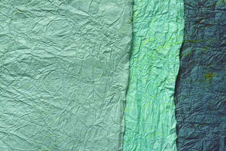 japanese abstract paper texture.3 colors of blue green and dark green. close up.