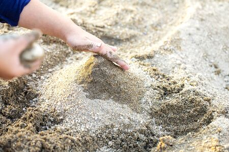 childs hands and sandbox play with sand and copy space. Sand art and play.