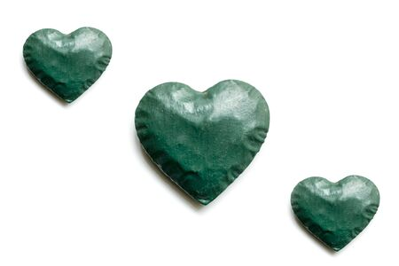 green hearts and white background and copy space.Flat lay.