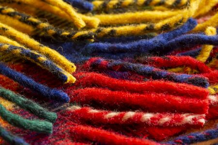 Close up of the colorful woolen yarn.red, yellow, green, dark blue.