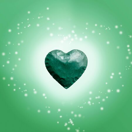 Energy of the light comes out of big green heart and copy space. bright, colorful with sparkly gteen background.