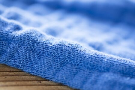 Background texture of blue pattern fabric made of cotton or linen.closeup.