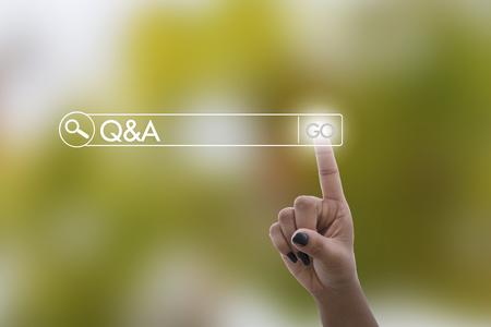 Women hand clicking Q&A or Question and Answer button on search toolbar with vintage style effect  soft focus picture