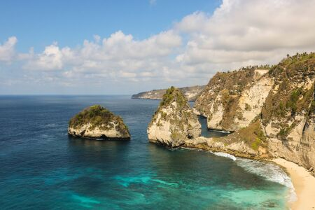 Panorama view of diamond beach in Nusa Penida Island. Bali, Indonesia. Landscape view of diamond beach with rocky and turquoise sea. diamond beach is tourist attraction. Travel concept