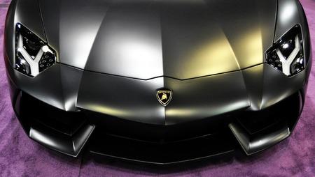 super car: Lamborghini hood on a purple carpet