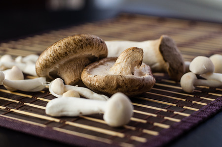 food basket: Close up of assorted Chinese mushrooms on a mat Stock Photo
