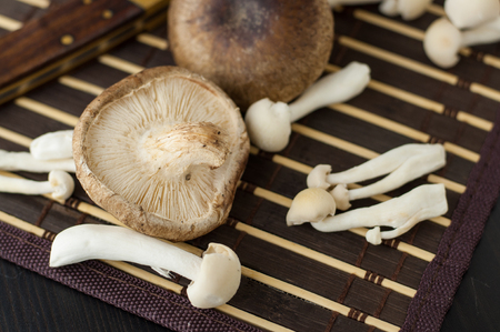 Close up of assorted Chinese mushrooms on a mat Stock Photo
