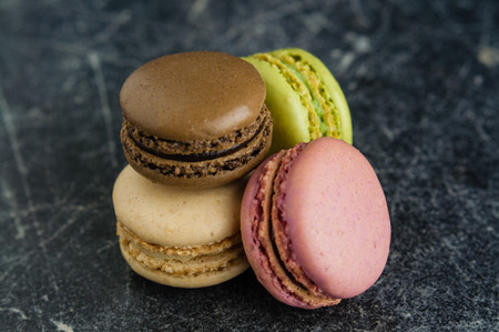 Stack of macaroons on a scratched old chalkboard background