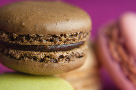 Chocolate  french macaroon blurred background closeup