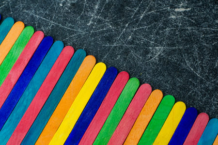 Colorful ice cream sticks on a chalkboard background space for text Stock Photo