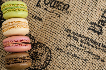 Close up macaroons on the jute tablecloth with space