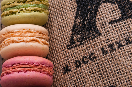 Close-up macaroons on the jute tablecloth with space