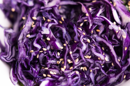 Purple cabbage slaw with sesame seeds close up