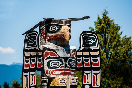 Eagle totem pole close up in New Westminster park, Vancouver, Canada, close up