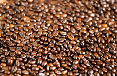 Freshly medium roasted coffee beans background Stock fotó