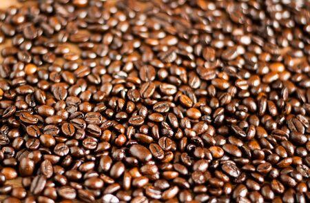 Freshly medium roasted coffee beans background Standard-Bild