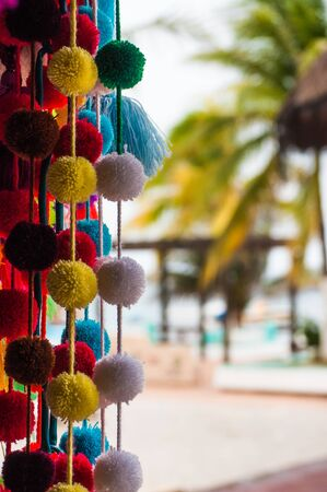 Handmade traditional Mexican souvenirs at the gift market in Puerto Morelos, Mexico, close up Standard-Bild