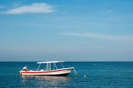 Small boat at the Caribbean sea, Mexico, coral reef snorkeling, negative space Standard-Bild