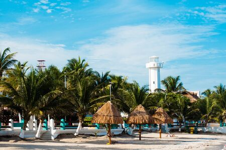 Lighthouse on the beach in Puerto Morelos, Mexico.