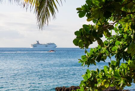 Cruise ship far at the horizon on the Caribbean sea, view from Cozumel Island, Mexico