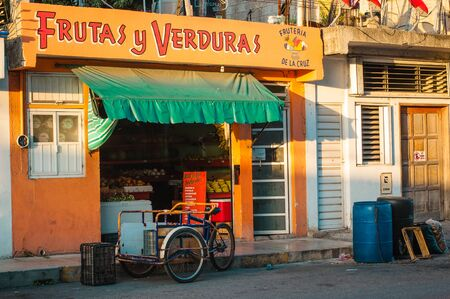 Playa del Carmen, Mexico - 22 August 2019 Colorful street Fruits and Vegetables store. Sign translation: