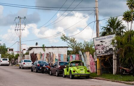 Cozumel Island, Mexico - 23 August 2019. Cars for rent parked alongside the street on Cozumel Island, Mexico