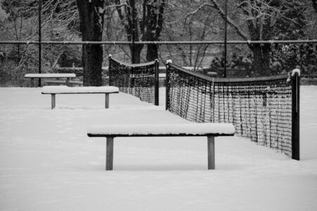 Empty tennis court covered with snow in the Stanley Park, Vancouver, Canada