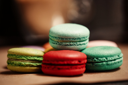 Pyramid of macarons cake. Food concept in bakery. Close-up photo. Macro photography.