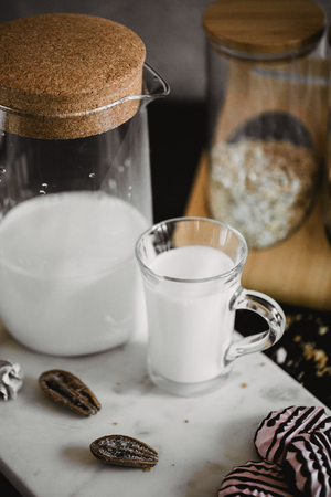 Flakes and cup of milk for breakfast. Concept of healthy food. Warm toning image. Rustic styling. Stock Photo