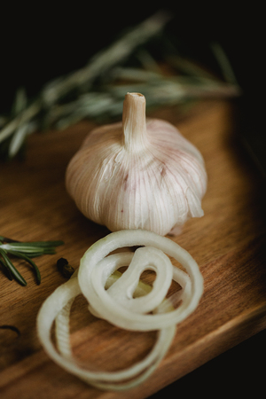 Healthy food with pranami spices and herbs, onion and garlic. Food photo for recipe or cookbook. Wooden black backround. Stock Photo