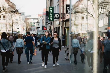 Nurnberg, Germany - April 5, 2018: People walking on the street in Old Town (Altstadt).