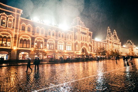 RUSSIA, MOSCOW, OCTOBER 13, 2017: Night scene of GUM department store. Raining evening with bokeh background. Editorial image in retro style