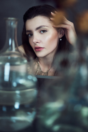 Beauty portrait of girl with water and reflections. Hight quality retouching photo. Fashion model. Stock Photo