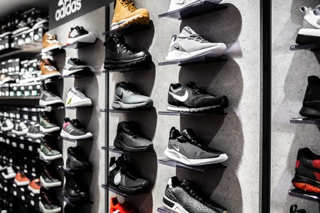 Nurmberg, GERMANY - February 27, 2019: The NIKE black sneakers on the shell in the shop. Fashionable foot wear shoes.