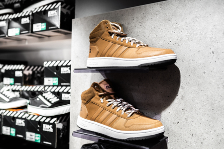 Nurmberg, GERMANY - February 27, 2019: The ADIDAS man sneakers on the shell in the shop. Fashionable foot wear shoes. Close up photo sport concept. Redakční