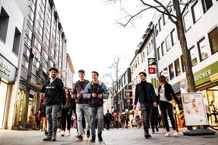 Nurmberg, GERMANY - February 27, 2019: people walking on the shopping street. Company of funny friends. Redakční