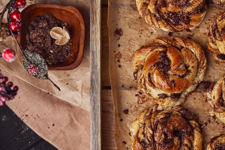 Buns with chocolate and cinnamon as cake food concept. Top view. Close up image. Stock Photo
