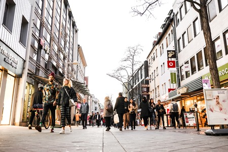 Nurmberg, GERMANY - February 27, 2019: Crowd of people walking on th shopping street.